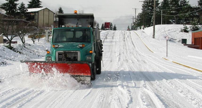 Image of snow plow on clearing snow from the streets in Tacoma