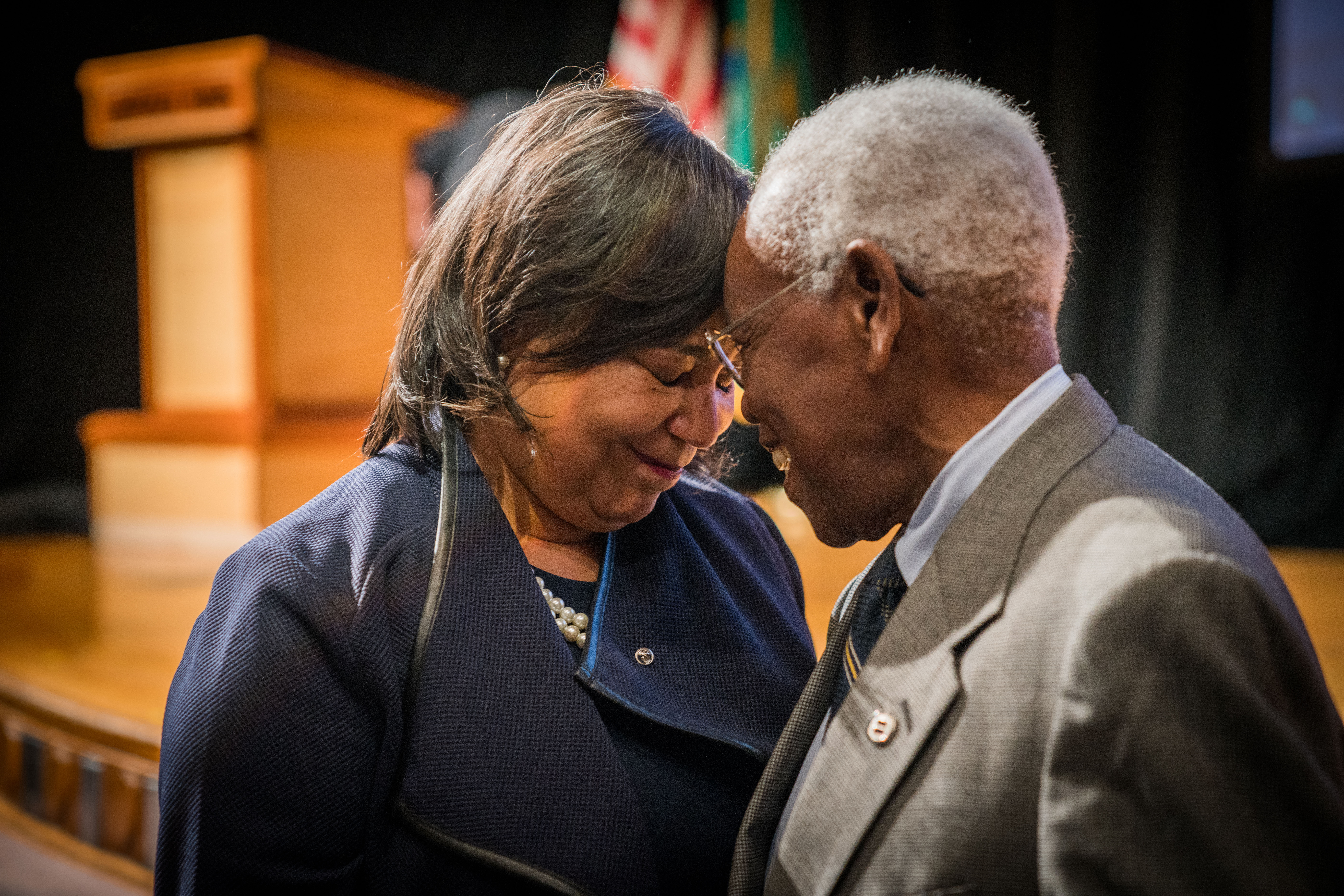 Mayor Victoria Woodards pauses to share a quiet moment with former Mayor Harold G. Moss after her first State of the City Address on April 11, 2018 at Lincoln High School in Tacoma, Washington. -- Courtesy of City of Tacoma