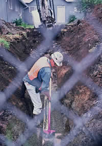 Man digging a ditch