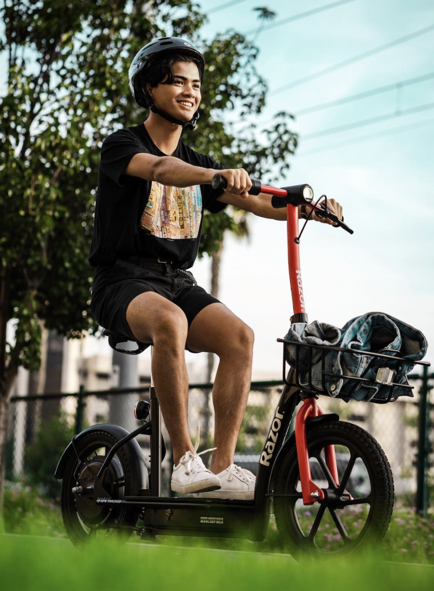 photo of man on scooter